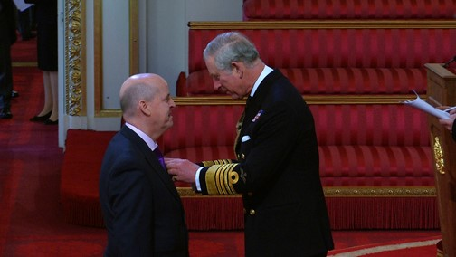 Richard Masters receiving his MBE from Prince Charles